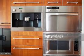 Kitchen Oven Cabinets Oven Microwave Cabinets And Sink In Modern Kitchen Stock Photo