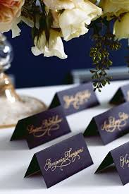 navy wedding ideas gold calligraphy wedding place cards