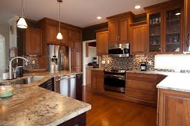 Kitchen With Mosaic Backsplash by Furniture Oak Yorktown Cabinets With Ventahoods And Merola Tile
