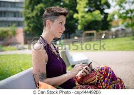 hipster hair for women beautiful hipster short hair woman in the park in the city stock