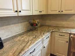 Backsplash For Kitchen With White Cabinet My New Kitchen Typhoon Bordeaux Granite With Travertine Tile