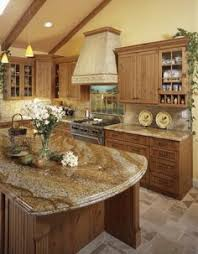 a large country kitchen with knotty alder cabinets cabinets have
