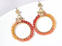 ora earrings orange and songea sapphires wire wrapped hoop earrings in gold