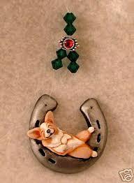 horseshoe christmas ornaments corgi snoozing in horseshoe 2007 christmas ornament by camille