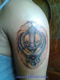 lion face with punjabi khanda tattoo design for shoulder golfian com