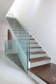 Glass Banisters For Stairs Wooden Stairs With Glass Balustrade In Modern Interior And White