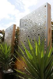 these gorgeous laser cut privacy screens create structure and