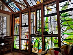 artist builds incredible stained glass cabin in the middle of the