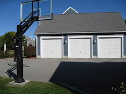 there is his pro dunk platinum basketball system in front of his 3 there is his pro dunk platinum basketball system in front of his 3 car garage
