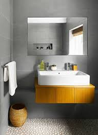 bathroom with wall mounted vanity with rectangular vessel sink and