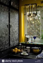 sponging paint effect on cupboard doors in nineties kitchen with