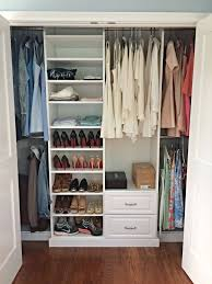 a nice simple and affordable white melamine reach in closet with
