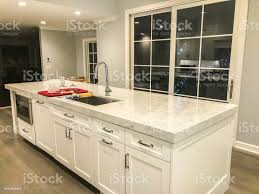 white kitchen cabinets wood floors modern white kitchen with marble countertop and porcelain tile floor looks like wood floor stock photo image now