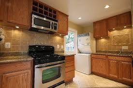 oak kitchen cabinets with stainless steel appliances dashiell photos kitchen cabinet colors kitchen remodel