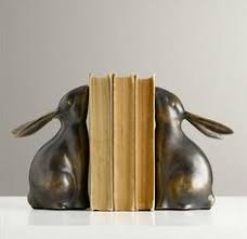 bunny bookends bookend bunny is putting a lot of effort into his task my