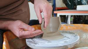 throwing a pot entering and lifting the sides of a cylinder when throwing a pot on