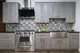 elegant cream kitchen cabinets with black countertops winters