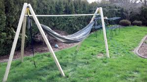 furniture hammock stands with wooden material and brown fabric