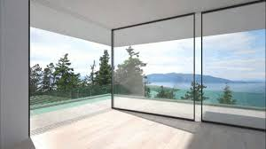 Glass Wall House by These Glass Walls Slide Around Corners To Disappear From View