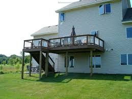2nd story deck example of a large classic backyard deck design in