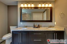 a master bathroom with espresso cabinets dual sinks and granite