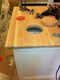 gallery 4 custom island butcher block top with finger pull cut out and trash bin below whole for easy cleanup