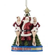 santa claus with the rockettes at radio city