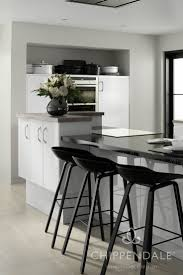 11 best gloss kitchen options images on pinterest gloss kitchen a striking gloss white kitchen with a multi function island design combining cooking