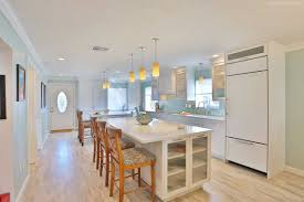 kitchen with two islands custom transitional white cabinets in venice florida
