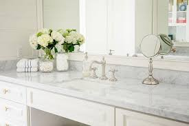 white bath vanity with gray marble counters and vintage faucet kit