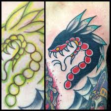wonderful traditional snake head tattoo design for sleeve