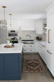 white kitchen cabinets with blue island 15 gorgeous white kitchens with coloured islands the happy