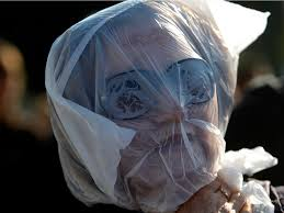 Challenge Suffocation Petros Giannakouris A Demonstrator Marches With A Plastic Bag