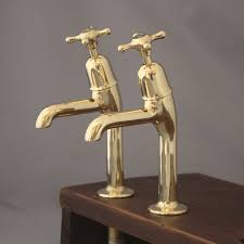 mid century pillar taps in polished brass ideal for belfast sinks