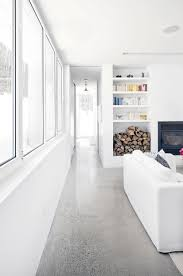black steel fireplace with high white wall shelves for books and