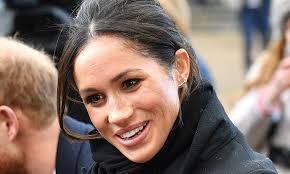mismatched earrings meghan markle wears mismatched earrings for official engagement in