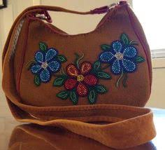 cree beaded floral design on moose hide made by monique b jolly
