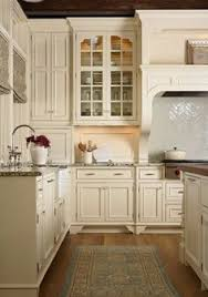 Cream Colored Kitchen Cabinets by Adding Bead Board And Molding To My Cabs Like This Beautiful