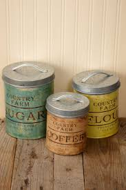 54 best images about rustic decor on pinterest mirror cabinets incorporate this set of three decorative metal canisters into your retro themed party or farmhouse chic inspired kitchen love the vintage labels