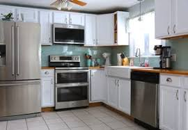 painting oak kitchen cabinets before and after how to clean your kitchen cabinets with tsp weekend craft