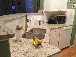Kitchen Backsplashes With Granite Countertops by New Giallo Ornamental Granite Countertops And Beveled Subway Tile