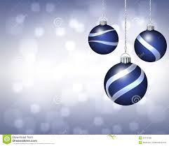 trio of blue and silver ornaments on twinkling backgro