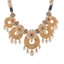 red stone gold necklace images Glossy finish rajasthani design studded with synthetic red stone jpg