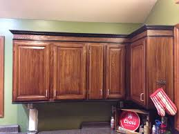 how to paint stained oak cabinets just stained the honey oak cabinets darker and added trim to