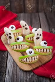 scary halloween food sausage meatball mummies in stock photo