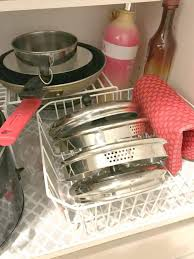 how to organize pots and pans in a cupboard how to organize pots and pans organized 31
