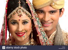 traditional dress up of indian weddings smiling indian newlywed in traditional wedding dress stock