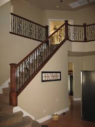 maple wood railing with box newel and scroll panels wrought iron