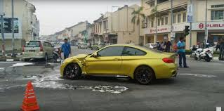 what is considered running a red light brand new bmw m4 gets hit by toyota running a red light in malaysia