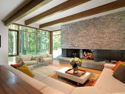 natural lighting floor to ceiling windows metal fireplace beige